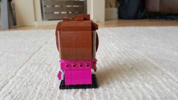 The back of a Lego Brickheadz style representation of Dolores Umbridge