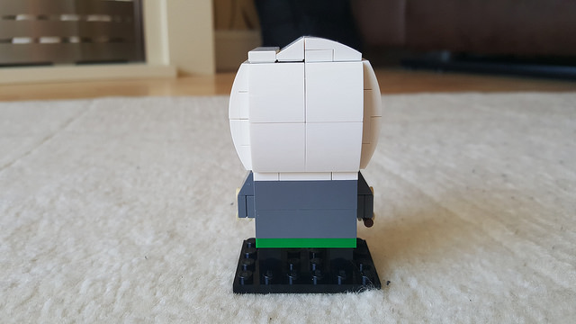 The back of Draco Malfoy represented in the Lego Brickheadz style