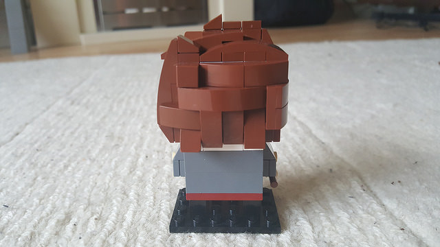 The back of Harry Potter represented in the Lego Brickheadz style